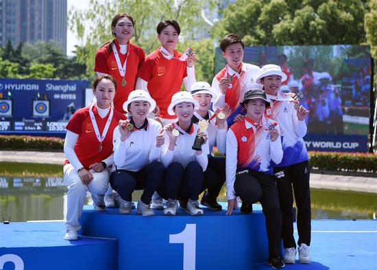 China's Zheng Yichai, Long Xiaoqing and Meng Fanxu (on the left) won the silver medal in the women's recurve team competition. The gold went to South Korea, with Chinese Taipei settling for bronze.