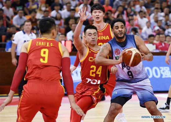 Corey Webster (R) of Australian NBL vies for the ball during the Sino-Australian Men's Basketball Challenge between China and Australia NBL team in Qingdao, east China's Shandong Province, June 19, 2019. (Xinhua/Li Ziheng)