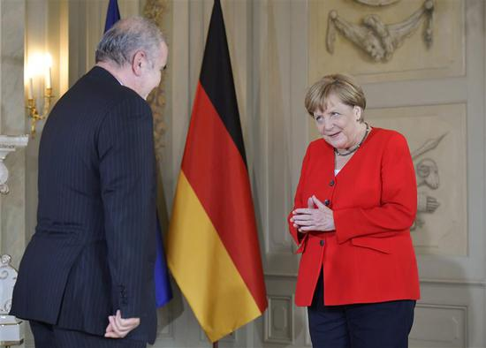 German Chancellor Merkel welcomes Ali Akbar Dabiran, Iran's representative to Germany, during a reception of the diplomatic corps at the German governmental guest house in Meseberg, northeastern Germany on July 9, 2019.