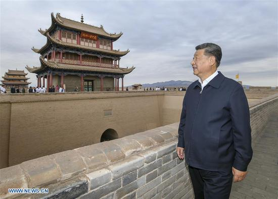 Chinese President Xi Jinping, also general secretary of the Communist Party of China Central Committee and chairman of the Central Military Commission, visits the Jiayu Pass, a famed part of the Great Wall in Jiayuguan City, during his inspection tour of northwest China's Gansu Province, Aug. 20, 2019. Xi also listened to an introduction to the historical and cultural background of the Great Wall and the passes in the Hexi Corridor, part of the ancient Silk Road in northwest China. (Xinhua/Xie Huanchi)