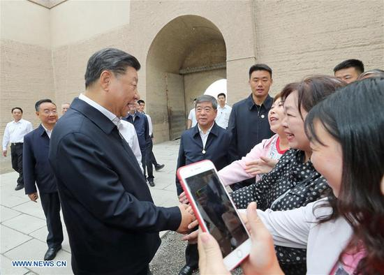 Chinese President Xi Jinping, also general secretary of the Communist Party of China Central Committee and chairman of the Central Military Commission, visits the Jiayu Pass, a famed part of the Great Wall in Jiayuguan City, during his inspection tour of northwest China's Gansu Province, Aug. 20, 2019. Xi also listened to an introduction to the historical and cultural background of the Great Wall and the passes in the Hexi Corridor, part of the ancient Silk Road in northwest China. (Xinhua/Ju Peng)