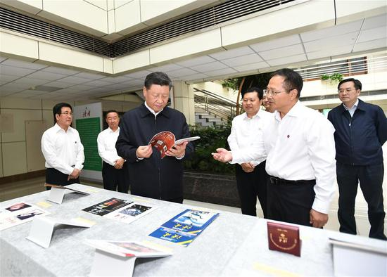 Chinese President Xi Jinping, also general secretary of the Communist Party of China Central Committee and chairman of the Central Military Commission, talks with local people during his inspection to Lanzhou, northwest China's Gansu Province, Aug. 21, 2019. (Xinhua/Ju Peng)