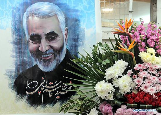 A portrait of the late Iranian senior general Qassem Soleimani is seen at the Iranian embassy in Damascus, Syria, on Jan. 5, 2020. The Iranian embassy in Damascus on Sunday organized a ceremony to honor Soleimani. (Photo by Ammar Safarjalani/Xinhua)