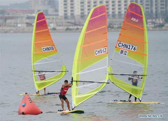 Huang Xianting of Fujian team competes during the women's RS:X class event at 2020 China's National Windsurfing Championships in Qinhuangdao, a coastal city of north China's Hebei Province, Sept. 2, 2020. (Xinhua/Yang Shiyao)