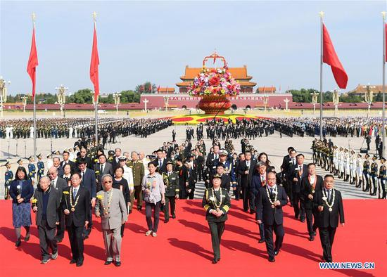 A ceremony presenting flower baskets to deceased national heroes is held at Tian'anmen Square to mark the Martyrs' Day in Beijing, capital of China, Sept. 30, 2020. (Xinhua/Shen Hong)