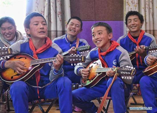 Students learn to play traditional musical instruments in a primary school in Aba County of Aba Tibetan and Qiang Autonomous Prefecture, southwest China's Sichuan Province, June 14, 2020. Located in northwest of Sichuan Province, with nearly one million population, Aba Tibetan and Qiang Autonomous Prefecture has a diversity of ethnic minority groups, including Tibetan, Qiang and Hui, etc. In recent years, to better inherit the ethnic culture, local schools have introduced more traditional cultural courses while local authorities set up training workshops about intangible cultural heritage to help local villagers learn traditional crafts, as a way to boost their incomes. In 2018, the production value of cultural industry in this prefecture has reached about 1.2 billion yuan (about 169.8 million U.S. dollars), accounting for 3.32 percent of gross domestic product (GDP) of this prefecture. (Xinhua/Liu Kun)