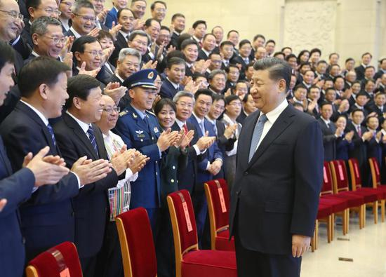 Chinese President Xi Jinping, also general secretary of the Communist Party of China (CPC) Central Committee and chairman of the Central Military Commission, meets with representatives honored for promoting cultural and ethical progress in Beijing, capital of China, Nov. 20, 2020. Wang Huning, a member of the Standing Committee of the Political Bureau of the CPC Central Committee and head of the Central Commission for Guiding Cultural and Ethical Progress, was present at the meeting. (Xinhua/Ju Peng)
