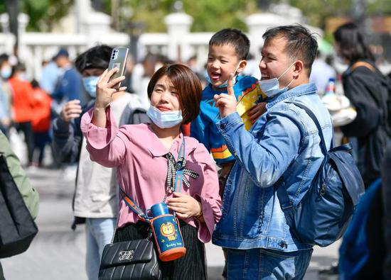 Tourists pose for selfie at the Italian Style Area in Hebei District of north China's Tianjin, May 1, 2021. (Xinhua/Sun Fanyue)