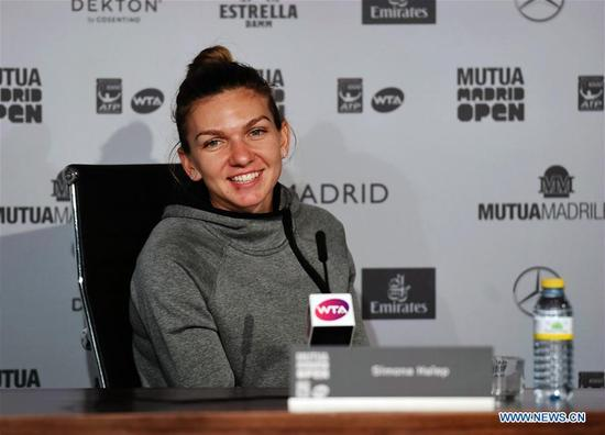 Simona Halep of Romania attends press conference after winning the women's individuals round 16 match against Kristyna Pliskova of Czech at the Madrid Open Tennis tournament in Madrid, Spain, May 9, 2018. (Xinhua/Guo Qiuda)
