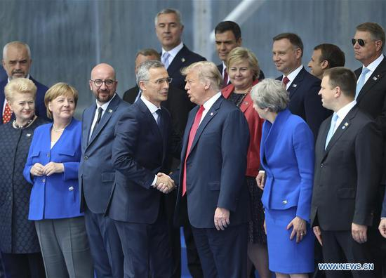 NATO Secretary General Jens Stoltenberg (center L) shakes hands with U.S. President Donald Trump during a NATO summit in Brussels, Belgium, July 11, 2018. NATO leaders gather in Brussels for a two-day meeting. (Xinhua/Ye Pingfan)
