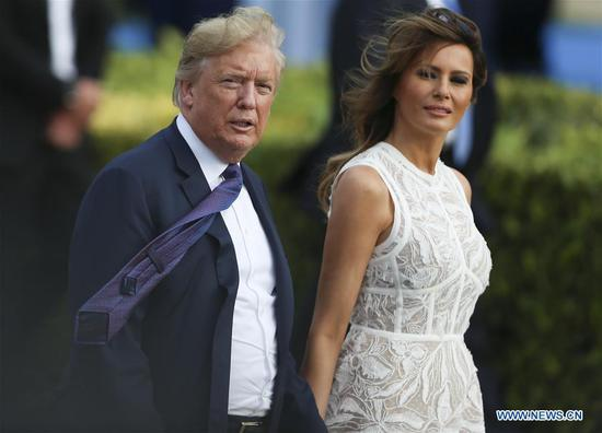 U.S. President Donald Trump and his wife Melania Trump take part in the family photo session during the North Atlantic Treaty Organization (NATO) summit in Brussels, Belgium, on July 11, 2018. The North Atlantic Treaty Organization (NATO) summit began Wednesday in Brussels with verbal fireworks as recent tensions between allies and the United States were laid bare by U.S. President Donald Trump in a growing row over burden sharing and foreign influence. (Xinhua/Ye Pingfan)