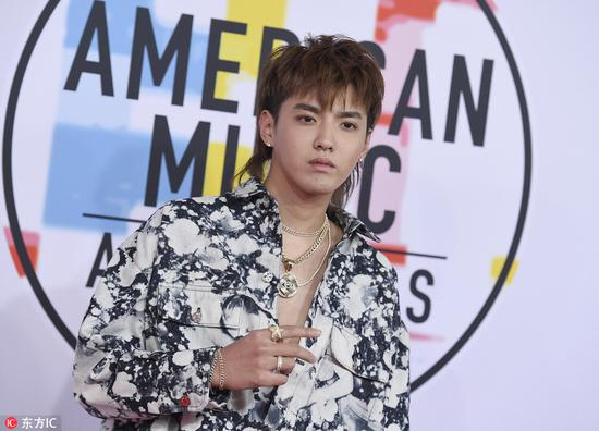 Kris Wu arrives at the American Music Awards on Oct 9, 2018 at the Microsoft Theater in Los Angeles. [Photo/IC]