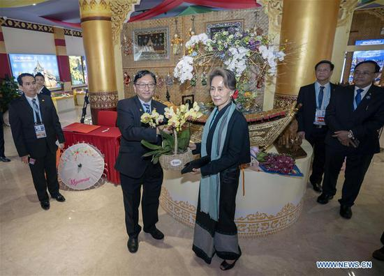 Myanmar's State Counselor Aung San Suu Kyi visits the Myanmar Garden at the International Horticulture zone of the International Horticultural Exhibition 2019 Beijing, in Beijing, capital of China, April 28, 2019. (Xinhua/Cai Yang)