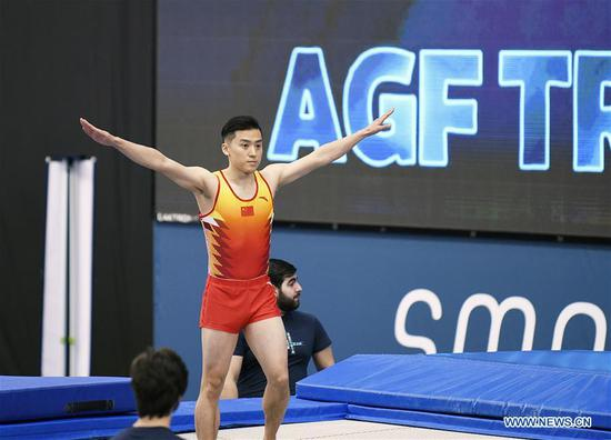 China's Dong Dong competes during the men's final of Trampoline Gymnastics at the 2020 FIG World Cup in Trampoline Gymnastics and Tumbling in Baku, Azerbaijan, Feb. 16, 2020. Dong Dong won the bronze. (Photo by Tofik Babayev/Xinhua)