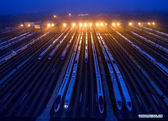 Aerial photo taken on Aug. 8, 2018 shows the Fuxing bullet trains running on the Beijing-Tianjin intercity rail in Tianjin, north China. The speed of Fuxing bullet trains running on the Beijing-Tianjin intercity rail increased to 350 km per hour Wednesday, cutting the journey to 30 minutes. (Xinhua/Yang Baosen)