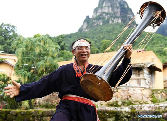 A villager performs Huangni drum dance in Jinxiu Yao Autonomous County, south China's Guangxi Zhuang Autonomous Region, Aug. 1, 2018. The local Huangni drum dance was listed as one of the national intangible cultural heritage in 2011. (Xinhua/Lu Boan)