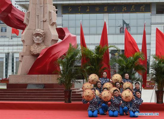 Staff members from Gansu Daily perform dance during an event marking the conclusion of an activity that took journalists to retrace the route of the Long March, in Huining, northwest China's Gansu Province, Aug. 18, 2019. The activity, held from June 11 to Aug. 18, was aimed at paying tribute to the revolutionary martyrs and passing on the traditions of revolution. The Long March was a military maneuver carried out by the Chinese Workers' and Peasants' Red Army from 1934 to 1936. During this period, they left their bases and marched through rivers, mountains and arid grassland to break the siege of Kuomintang forces and continue to fight Japanese aggressors. Many marched as far as 12,500 km. (Xinhua/Ma Ning)