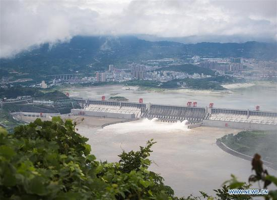 Aerial photo taken on June 29, 2020 shows water gushing out from sluiceways of the Three Gorge reservoir on the Yangtze River in central China's Hubei Province. Due to heavy rain in the upper streams of the Yangtze River, the Three Gorge reservoir has been seeing an increase of inflow recently. (Xinhua/Xiao Yijiu)