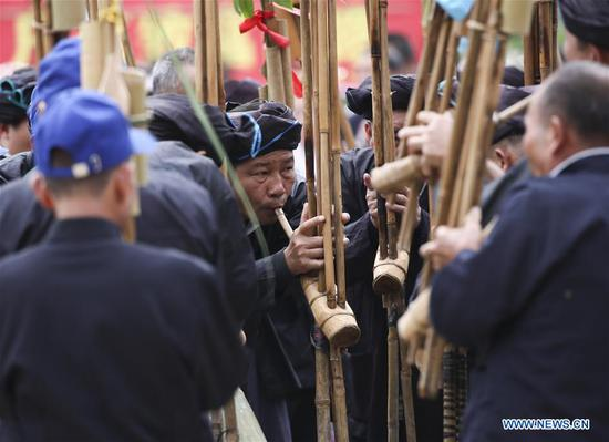 People of Dong ethnic group play lusheng, a musical instrument made of multiple bamboo pipes, during a harvest festival in Dongtou Village, Rongshui Miao Autonomous County, south China's Guangxi Zhuang Autonomous Region, Oct. 26, 2018. Local people celebrated harvest Friday through various activities like fish feast, singing and playing lusheng. (Xinhua/Lan Hongguang)
