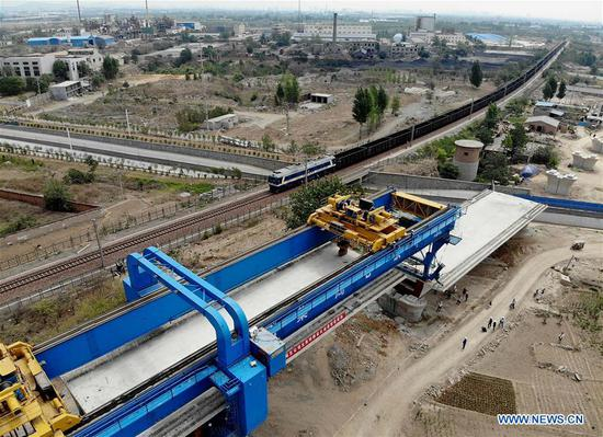 Aerial photo taken on June 16, 2019 shows a box girder installation site on new Taiyuan-Jiaozuo high-speed railway in Shangtun Village of Boai County in Jiaozuo, central China's Henan Province. The first box girder in the Henan section of the railway was installed here Sunday, marking an important progress in the construction of the new high-speed railway linking Taiyuan, north China's Shanxi Province, and Jiaozuo in Henan. The 362-km railway line is expected to start service in 2020 with a designed speed of 250 kilometers per hour. (Xinhua/Li An)