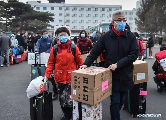 Medical workers are seen before leaving for Wuhan of Hubei Province, in Beijing, capital of China, Jan. 27, 2020. A team comprised of 136 medical workers from Beijing left for Wuhan City on Monday to aid the novel coronavirus control efforts there. (Xinhua/Peng Ziyang)