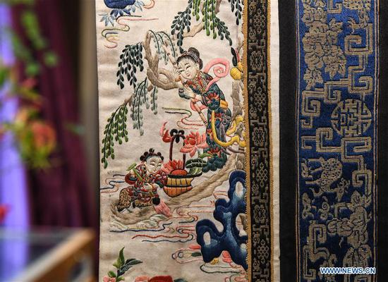 Photo taken on June 3, 2018 shows a piece of cloth with exquisite embroidery during an exhibition of traditional costumes and embroidery artworks in Beijing, capital of China. (Xinhua/Li He)