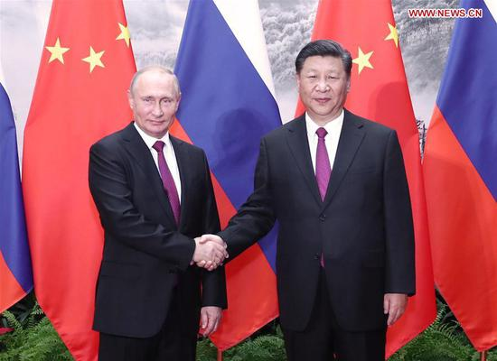Chinese President Xi Jinping holds talks with his Russian counterpart Vladimir Putin in Beijing, capital of China, June 8, 2018. (Xinhua/Ju Peng)