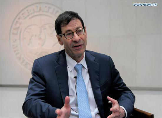 Photo taken on July 24, 2018 shows International Monetary Fund (IMF) chief economist Maurice Obstfeld speaking during an interview with Xinhua in Washington D.C., the United States. (Xinhua/Yang Chenglin)