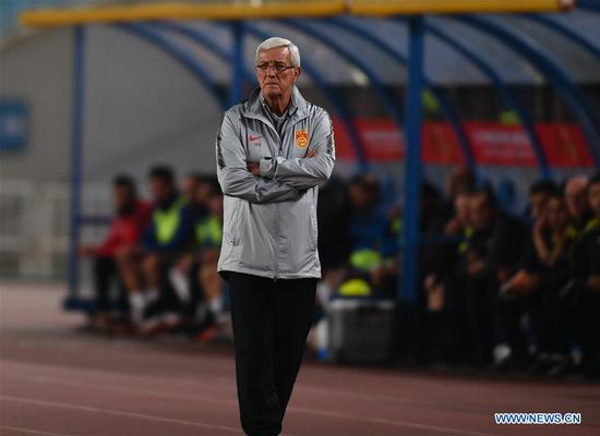 Marcello Lippi, head coach of China looks on during the CFA Team China International Football Match 2018 between China and Syria in Nanjing, capital of east China's Jiangsu Province, Oct. 16, 2018. China won 2-0. (Xinhua/Ji Chunpeng)