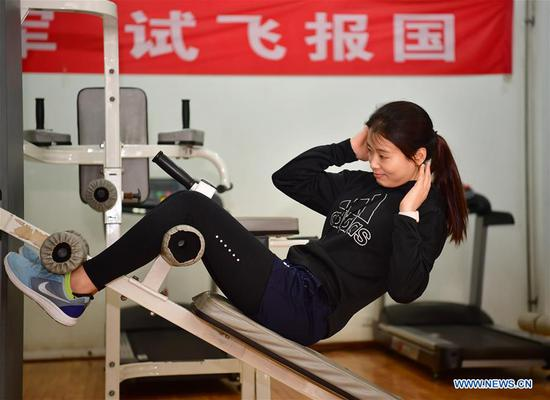 Jiang Dandan exercises at a physical training center for flight tester in Yanliang District of Xi'an, capital of northwest China's Shaanxi Province, on March 5, 2019. Jiang Dandan, 29, is one of the youngest test pilots in China and the only female test pilot for commercial transport aircrafts currently being trained at the Aviation Industry Corporation of China, Ltd. She went through dozens of professional courses and 750 hours of flying practice in six years. At the end of 2017, she became a test pilot and participated in the test flights during the research and development of ARJ21-700, C919 and other types of aircrafts. (Xinhua/Shao Rui)