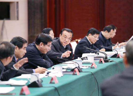 Chinese Premier Li Keqiang, also a member of the Standing Committee of the Political Bureau of the Communist Party of China (CPC) Central Committee, presides over a symposium on the economic situation and basic livelihood of some provincial-level regions in Nanchang, east China's Jiangxi Province, Nov. 14, 2019. (Xinhua/Liu Weibing)
