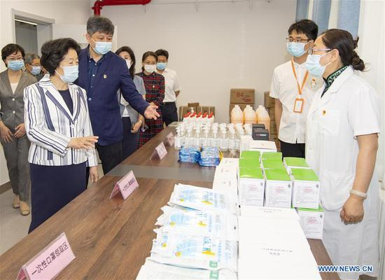 Chinese Vice Premier Sun Chunlan, also a member of the Political Bureau of the Communist Party of China Central Committee, checks the reserves of epidemic prevention materials at Beijing Huiwen Middle School in Beijing, capital of China, June 1, 2020. Sun conducted inspection visits to a secondary school, a primary school, and a kindergarten in Beijing on Monday. Sun visited children who had returned to school, extending her greetings to them on International Children's Day. At the same time, she inspected measures to prevent and control COVID-19 in the schools. (Xinhua/Gao Jie)