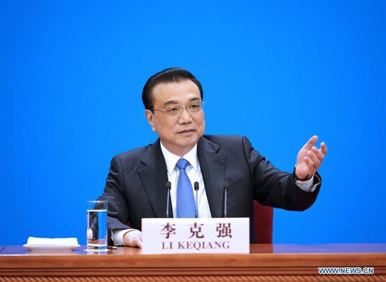 Chinese Premier Li Keqiang meets the press after the conclusion of the second session of the 13th National People's Congress (NPC) at the Great Hall of the People in Beijing, capital of China, March 15, 2019. (Xinhua/Xing Guangli)