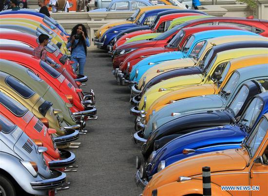 Photo taken on July 1, 2018 shows colorful Volkswagen cars in Colombo, Sri Lanka. The Volkswagen Beetle Owners' Club held an annual World Volkswagen Day celebration in Colombo on Sunday. (Xinhua/Ajith Perera)