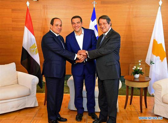 Egyptian President Abdel Fattah al-Sisi (L) shakes hands with Greek Prime Minister Alexis Tsipras (C) and Cyprus President Nicos Anastasiades during the trilateral summit on Crete island, Greece, on Oct. 10, 2018. Greece, Cyprus and Egypt signed agreements for collaboration in education, business and small and medium sized enterprises, customs and border technology, as well as the promotion of investments during a trilateral summit hosted on Crete island on Wednesday, Greek national news agency AMNA reported. (Xinhua/MENA)