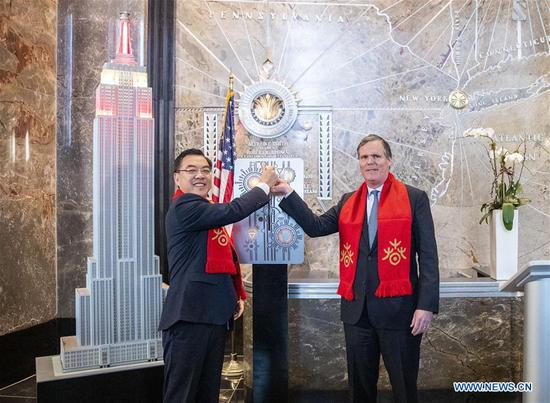 Chinese Consul General in New York Huang Ping (L) and John B. Kessler, president of the Empire State Realty Trust Inc., flip the switch to light a model of Empire State Building during the lighting ceremony for Chinese Spring Festival at the Empire State Building in Manhattan, New York, the United States, on Feb. 1, 2019. The top of the landmark Empire State Building in Manhattan will shine in red, blue and yellow on the nights of next Monday and Tuesday to celebrate the Chinese New Year, which falls on Feb. 5 this year. (Xinhua/Wang Ying)