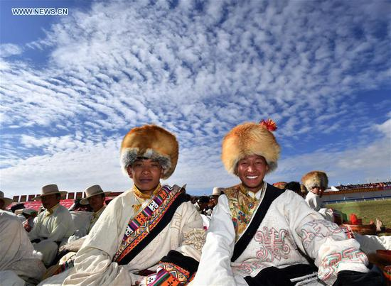 People wearing hats are seen during a horse racing festival in Nagqu City, southwest China's Tibet Autonomous Region, Aug. 10, 2019. People in Amdo County of Nagqu City have a tradition of wearing hats, which are now mostly made from lamb skins and artificial leather.The hat usually has an antenna-like stripe of fabric at the top. (Xinhua/Chogo)