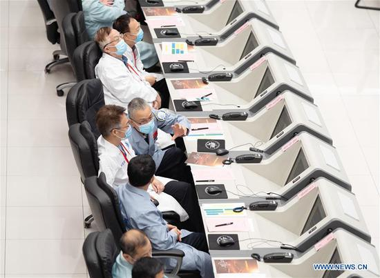 Technical personnel work at the Beijing Aerospace Control Center (BACC) in Beijing, capital of China, Aug. 2, 2020. China's Mars probe Tianwen-1 successfully carried out its first orbital correction at 7 a.m. (2300 GMT Saturday) after its 3,000N engine worked for 20 seconds, and continued to head for the Mars. (Xinhua/Cai Yang)