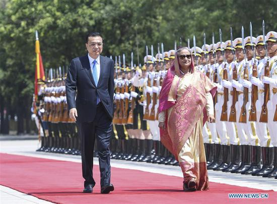Chinese Premier Li Keqiang holds a welcome ceremony for Bangladeshi Prime Minister Sheikh Hasina, who is paying an official visit to China, ahead of their talks at the Great Hall of the People in Beijing, capital of China, July 4, 2019. (Xinhua/Zhang Ling)
