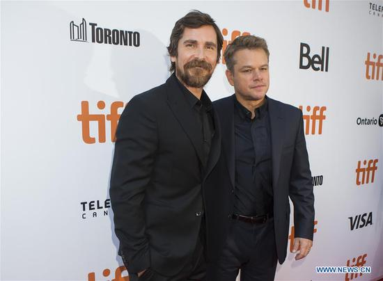 Actors Matt Damon (R) and Christian Bale pose for photos before the international premiere of the film