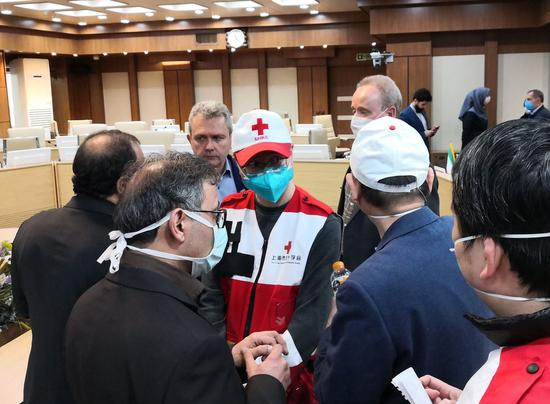 Chinese medical team members meet with Iranian medical experts in Tehran, Iran, March 7, 2020. (Xinhua)