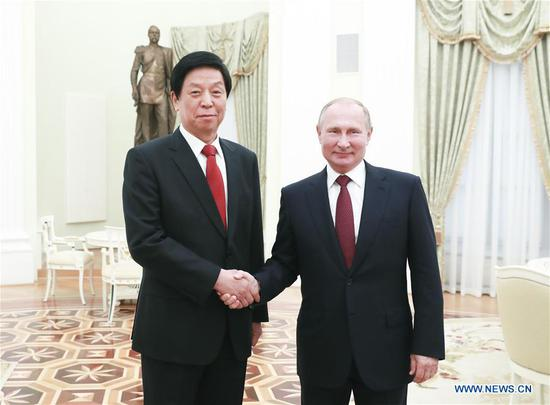 Li Zhanshu, chairman of the Standing Committee of the National People's Congress of China, meets with Russian President Vladimir Putin in Moscow, Russia, Sept. 25, 2019. Li paid an official goodwill visit to Russia from Sept. 25 to 28. (Xinhua/Pang Xinglei)