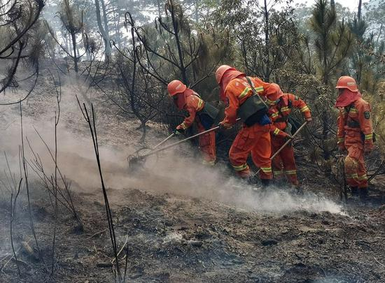 Firefighters put out a forest fire in Xichang, southwest China's Sichuan Province, March 31, 2020. (Photo by Li Jieyi/Xinhua)