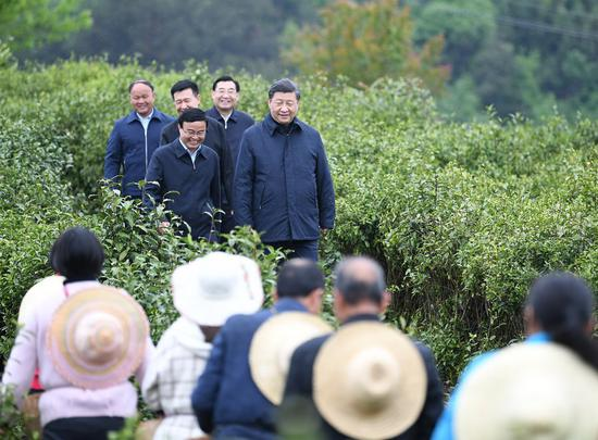 Chinese President Xi Jinping, also general secretary of the Communist Party of China Central Committee and chairman of the Central Military Commission, inspects poverty alleviation work in a tea farm of Laoxian Township, Pingli County of Ankang, northwest China's Shaanxi Province, April 21, 2020.Xi visited Shaanxi Province on an inspection tour from April 20 to 23, 2020. (Xinhua/Yan Yan)