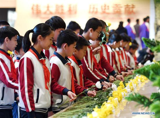 Students lay flowers to pay tribute to revolutionary martyrs during a campaign at the Museum of the War of Chinese People's Resistance Against Japanese Aggression in Beijing, capital of China, April 4, 2019. China has kicked off a campaign to promote paying tribute to revolutionary martyrs as Tomb-sweeping Day draws near. The campaign is aimed at combining educational activities with paying tribute. Tomb-sweeping Day, also known as Qingming Festival, falls on April 5 this year. It is a traditional Chinese holiday where people pay tribute to deceased family and friends. (Xinhua/Zhang Chenlin)