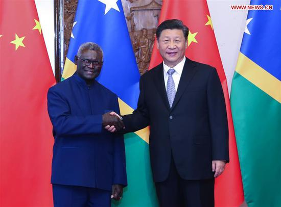 Chinese President Xi Jinping meets with Solomon Islands' Prime Minister Manasseh Sogavare at the Diaoyutai State Guesthouse in Beijing, capital of China, Oct. 9, 2019. (Xinhua/Yao Dawei)