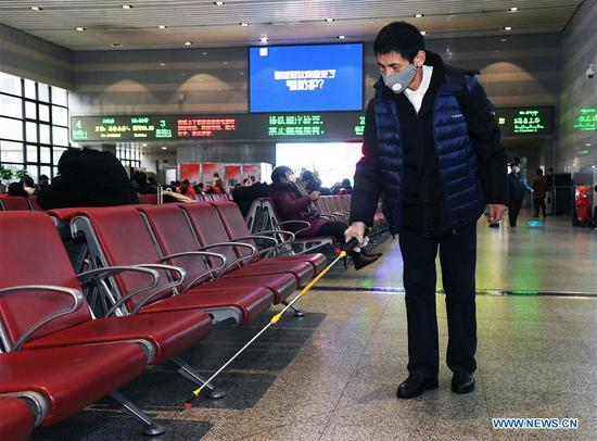 A staff member disinfects a lobby of Beijing West Railway Station in Beijing, capital of China, Feb. 2, 2020. Chinese authorities have tightened measures to battle the novel coronavirus epidemic as a growing number of people hit the road and return to work after the Spring Festival holiday. (Photo by Ren Chao/Xinhua)