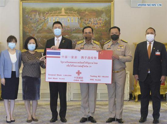 Thai Prime Minister Prayut Chan-o-cha (3rd R), Deputy Prime Minister and Public Health Minister Anutin Charnvirakul (2nd R) and Yang Xin (3rd L), charge d'affaires of the Chinese Embassy to Thailand, attend a donation handover ceremony in Bangkok, Thailand, June 29, 2020. Thai Prime Minister Prayut Chan-o-cha on Monday expressed his gratitude via the Thai media for China's donation of a batch of medical equipment to fight the COVID-19 outbreak in Thailand. (Xinhua/Rachen Sageamsak)