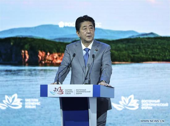 Japanese Prime Minister Shinzo Abe addresses the plenary session of the fourth Eastern Economic Forum (EEF) in Vladivostok in Russia's Far East, on Sept. 12, 2018. (Xinhua/Pang Xinglei)