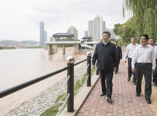 Chinese President Xi Jinping, also general secretary of the Communist Party of China Central Committee and chairman of the Central Military Commission, visits a Yellow River management point to learn about the management, protection and flood control project construction of the Yellow River in Lanzhou, northwest China's Gansu Province, Aug. 21, 2019. (Xinhua/Wang Ye)